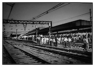 Rush hour commuters wait on Howrah Station platforms, Calcutta, India.