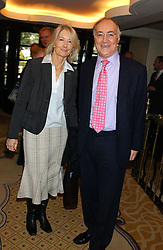 MICHAEL HOWARD MP and SANDRA HOWARD at The Sir Peter O'Sullevan Charitable Trust Lunch at The Savoy, London on 23rd November 2005.<br />