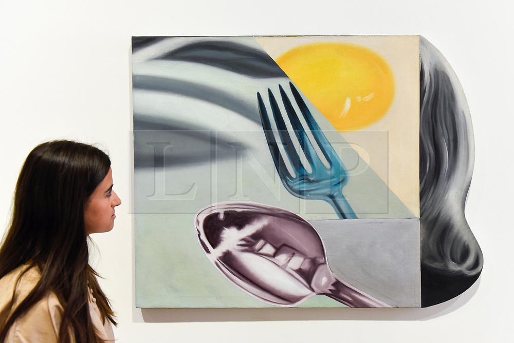 """© Licensed to London News Pictures. 10/09/2019. LONDON, UK. A staff member views """"Coenties Slip Studio"""", 1961, at a preview of """"Visualising the Sixties"""", the first in depth exhibition of works by artist James Rosenquist.  From a painter of commercial billboards in New York City, to a fine art career as a Pop artist, Rosenquist's work was described as Andy Warhol's favourite.  The exhibition is on at Galerie Thaddaeus Ropac in Mayfair 10 September to 9 November.  Photo credit: Stephen Chung/LNP"""