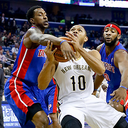 Dec 11, 2013; New Orleans, LA, USA; Detroit Pistons shooting guard Kentavious Caldwell-Pope (5) knocks the ball away from New Orleans Pelicans shooting guard Eric Gordon (10) during the first quarter at New Orleans Arena. Mandatory Credit: Derick E. Hingle-USA TODAY Sports