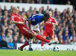 LIVERPOOL, ENGLAND - Sunday, October 17, 2010: Liverpool's Martin Skrtel and Everton's Ayegbeni Yakubu during the 214th Merseyside Derby match at Goodison Park. (Photo by David Rawcliffe/Propaganda)