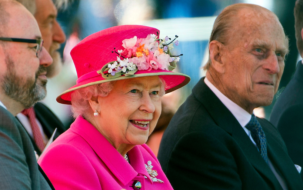 Britain's Queen Elizabeth II (centre) and Prince Philip, Duke of Edinburgh (right) visit Alexandra Park, Windsor, Britain, 20 April 2016. The Queen opened a new bandstand in the park on the eve of her 90th birthday. EPA/WILL OLIVER