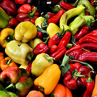 Multi-color Bell Peppers and Red Chili Peppers at Farmers Market in Vancouver, Canada