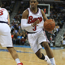 28 January 2009: New Orleans Hornets guard Chris Paul (3) drives with the ball during a 94-81 win by the New Orleans Hornets over the Denver Nuggets at the New Orleans Arena in New Orleans, LA. The Hornets wore special throwback uniforms of the former ABA franchise the New Orleans Buccaneers for the game as they honored the Bucs franchise as a part of the NBA's Hardwood Classics series. .