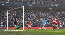 MANCHESTER, ENGLAND - Sunday, January 8, 2012: Manchester City's Sergio Aguero scores the second goal against Manchester United during the FA Cup 3rd Round match at the City of Manchester Stadium. (Pic by Vegard Grott/Propaganda)