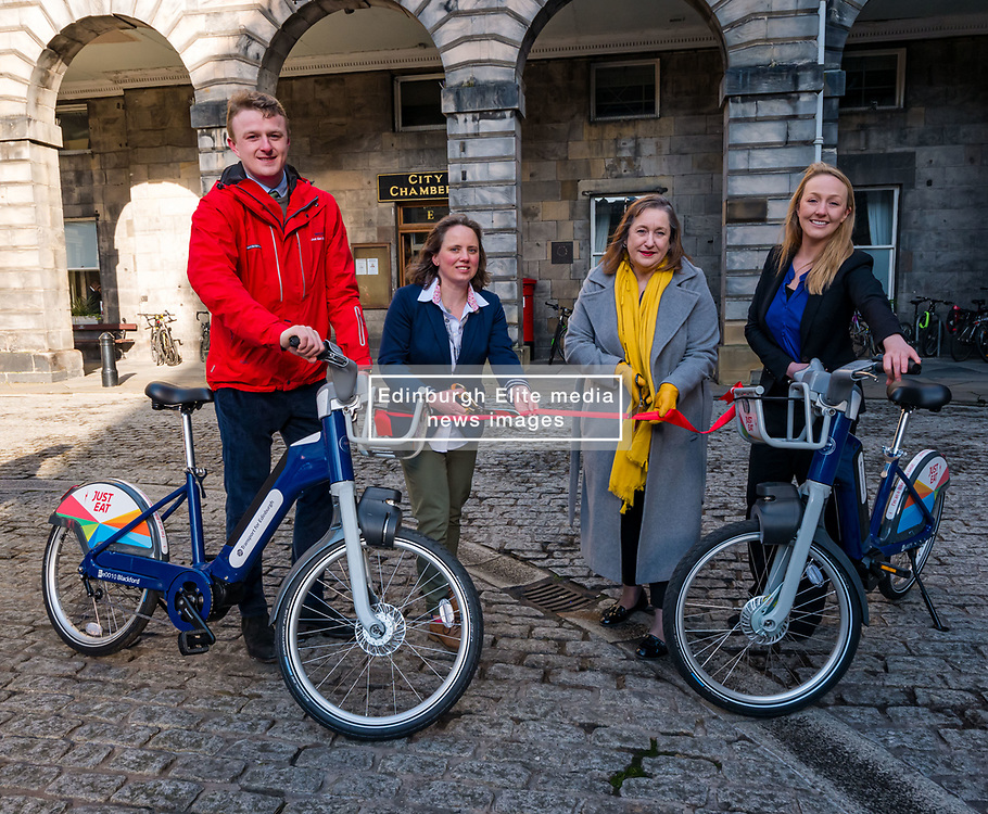 City Chambers, Edinburgh, Scotland, United Kingdom, Just Eat E-bikes: A new fleet of 163 rentable e-bikes are launched and integrated into the capital's existing cycle hire scheme by Just Eat Cycles. Edinburgh will now have the largest docked e-bike fleet in UK.  Pictured: Alex Mcdonald, General Manager Serco, Katherine Soane, Senior Project Officer, TfE Cycle Hire, Lesley McInnes, Transport & Environment Convener & Ellie Grebenik, Senior Programme Manager at Energy Saving Trust<br /> Sally Anderson | EdinburghElitemedia.co.uk