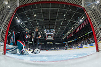 KELOWNA, CANADA - DECEMBER 1:  Kelowna Rockets' athletic therapist Scott Hoyer heads to the net to assess Roman Basran #30 after a collision with the Saskatoon Blades on December 1, 2018 at Prospera Place in Kelowna, British Columbia, Canada.  (Photo by Marissa Baecker/Shoot the Breeze)