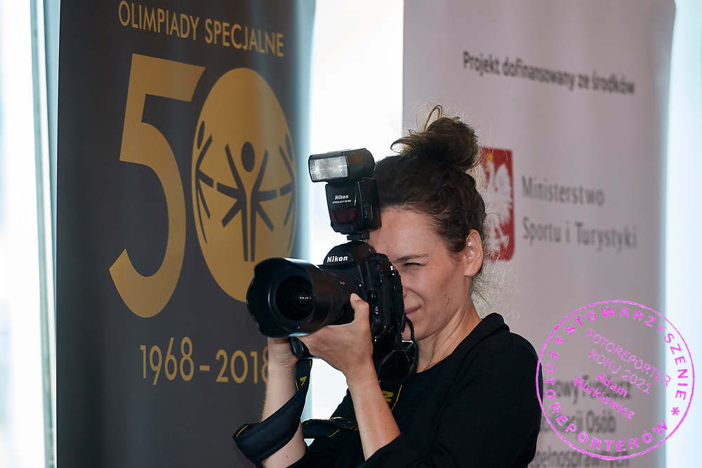 Warsaw, Poland - 2018 May 10: Photographer shoots pictures while Special Olympics Press Conference at Marriott Champions Sport Bar on May 10, 2018 in Warsaw, Poland.<br /> <br /> Adam Nurkiewicz declares that he has no rights to the image of people at the photographs of his authorship.<br /> <br /> Picture also available in RAW (NEF) or TIFF format on special request.<br /> <br /> Any editorial, commercial or promotional use requires written permission from the author of image.<br /> <br /> Image can be used in the press when the method of use and the signature does not hurt people on the picture.<br /> <br /> Mandatory credit:<br /> Photo by &copy; Adam Nurkiewicz / Mediasport