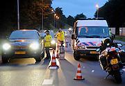 Nederland, Ubbergen, 12-5-2011Vlak buiten Nijmegen voert de politie een verkeerscontrole uit. Vanwege een groot evenement, de vierdaagse. Bestuurders moeten blazen voor alkohol. Foto: Flip Franssen/Hollandse Hoogte