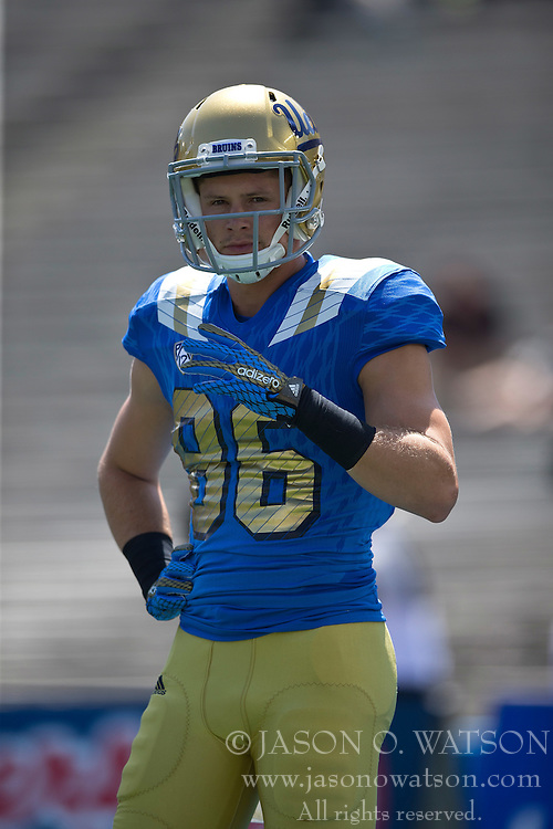 PASADENA, CA - SEPTEMBER 05:  Wide receiver Logan Sweet #86 of the UCLA Bruins warms up before the game against the Virginia Cavaliers at the Rose Bowl on September 5, 2015 in Pasadena, California.  The UCLA Bruins defeated the Virginia Cavaliers 34-16. (Photo by Jason O. Watson/Getty Images) *** Local Caption *** Logan Sweet