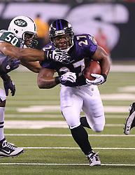 Sept 13, 2011; East Rutherford, NJ, USA; Baltimore Ravens running back Ray Rice (27) runs with the ball past New York Jets defensive end Vernon Gholston (50) during the first half at the New Meadowlands Stadium.