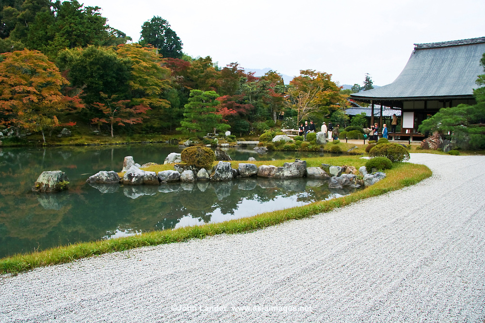 "Tenryuji has been ranked first among Kyoto's ""Five Great Zen Temples"". Tenryuji was established in 1339, and like many other temples burnt down several times over its history. Muso Soseki, the temple's founding abbot and famous garden designer, created Tenryuji's landscape garden which, unlike the temple buildings, survived the many fires and is considered one of the oldest of its kind, that is ""borrowed landscape"" garden, taking in the background scenery of the hills of  Arashiyama as part of the garden's composition. Sogenchi pond and Ishigumi rock clusters in the garden are this pond garden's essential ingredients."
