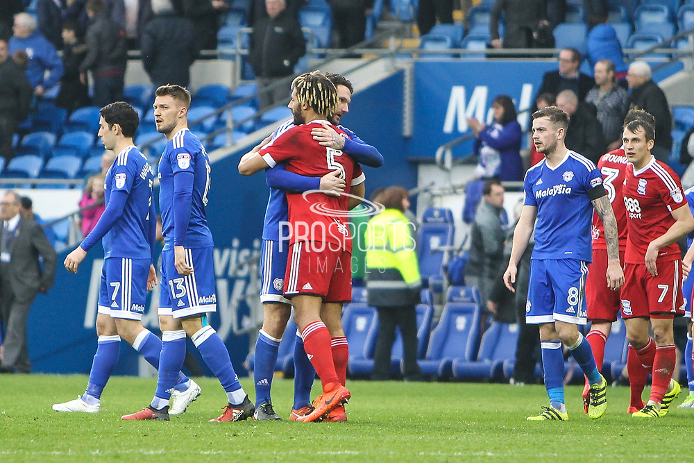 Sean Morrison of Cardiff City and Ryan Shotton of Birmingham City embrace after the EFL Sky Bet Championship match between Cardiff City and Birmingham City at the Cardiff City Stadium, Cardiff, Wales on 11 March 2017. Photo by Andrew Lewis.