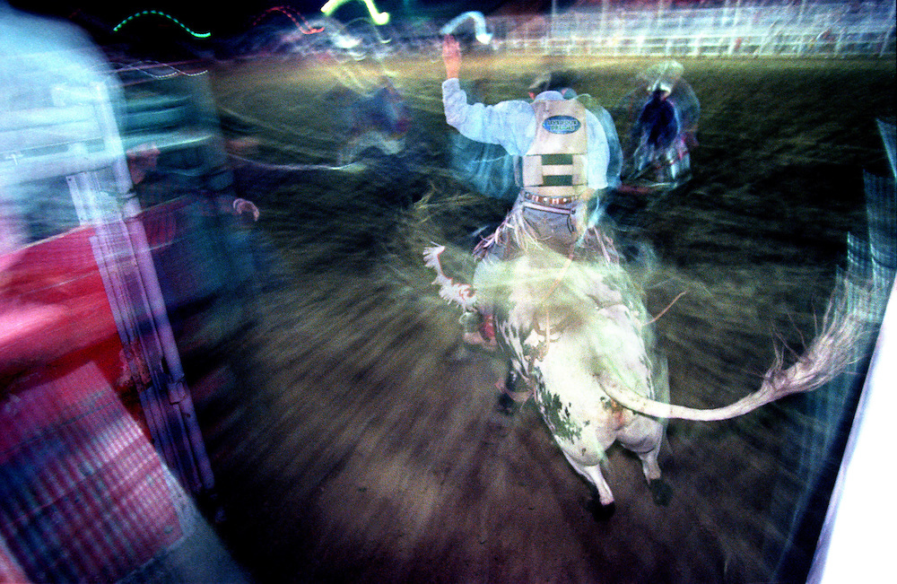 A bull rider exits the chute for an eight second ride