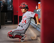 Aug. 10, 2012; Phoenix, AZ, USA; Washington Nationals catcher Kurt Suzuki (24) stretches in the dugout prior to the game against the Arizona Diamondbacks at Chase Field.  Mandatory Credit: Jennifer Stewart-US PRESSWIRE