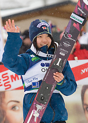 Second placed Sara Takanashi of Japan celebrates during trophy ceremony after the Normal Hill Individual Competition at FIS World Cup Ski jumping Ladies Ljubno 2012, on February 12, 2012 in Ljubno ob Savinji, Slovenia. (Photo By Grega Valancic / Sportida.com)