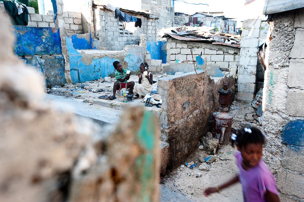 In Delmas 2 area of Port au Prince, children play in the rubble. Almost 10 months on from the earthquake which struck the city on January 12th, much of the rubble remains on the streets.