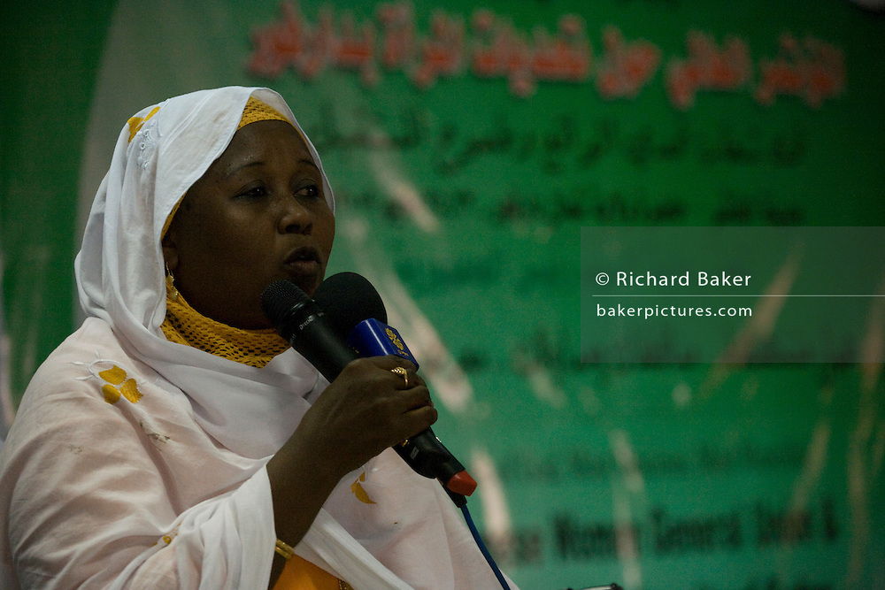 A Sudanese woman has the opportunity to speak her mind from the stage while attending the first-ever international Conference on Womens' Challenge in Darfur, gather in a compound belonging to the Govenor of Noth Darfur in Al Fasher (also spelled, Al-Fashir) where the women from remote parts of Sudan gathered to discuss peace and political issues.