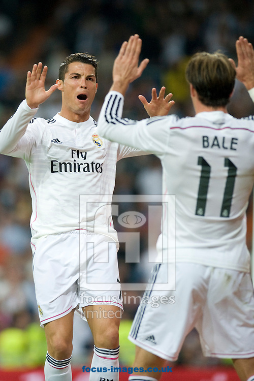 Cristiano Ronaldo of Real Madrid scores 3-0 and celebrates with Gareth Bale during the La Liga match at the Estadio Santiago Bernabeu, Madrid<br /> Picture by Marcos Calvo Mesa/Focus Images Ltd +34 654142934<br /> 05/10/2014
