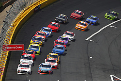 May 26, 2018 - Concord, North Carolina, United States of America - Kyle Busch (18) and Cole Custer (00) lead the field off turn four during a restart for the Alsco 300 at Charlotte Motor Speedway in Concord, North Carolina. (Credit Image: © Chris Owens Asp Inc/ASP via ZUMA Wire)