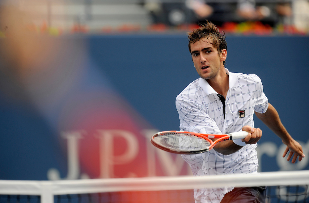 NEW YORK - SEPTEMBER 08: Marin Cilic hits the ball back to Andy Murray during day nine of the 2009 U.S. Open at the USTA Billie Jean King National Tennis Center on September 8, 2009 in Flushing neighborhood of the Queens borough of New York City. (Photo by Rob Tringali) *** Local Caption *** Marin Cilic