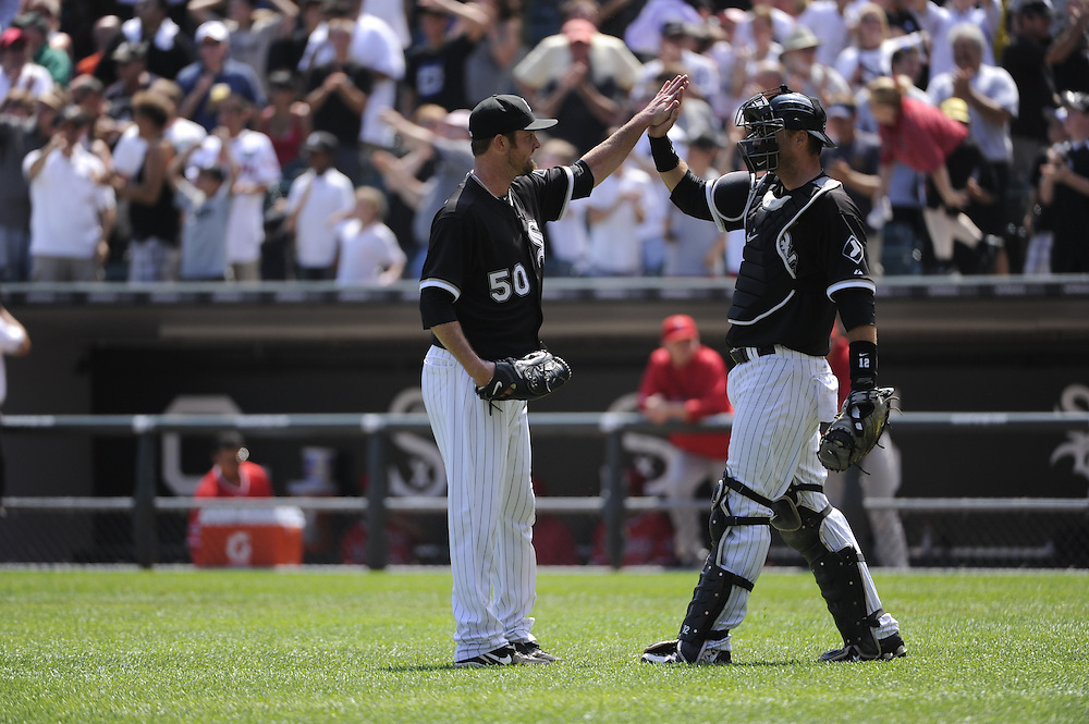 CHICAGO - JULY 08:  John Danks #50 celebrates with A.J. Pierzynski #12 of the Chicago White Sox after the game against the Los Angeles Angels of Anaheim on July 8, 2010 at U.S. Cellular Field in Chicago, Illinois.  Danks pitched a complete game shutout.  The White Sox defeated the Angels 1-0.  (Photo by Ron Vesely)