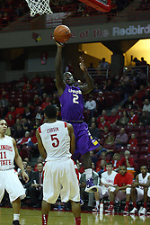 19 November 2011:  Anthony Cousin stands pat and draws a charge from Zavion Williams during an NCAA mens basketball game between the Lipscomb Bison and the Illinois State Redbirds in Redbird Arena, Normal IL
