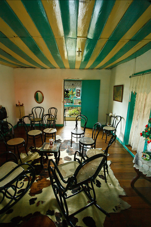 Interior of a typical house with an open  door into an enclosed yard, Salento, Quindio, Colombia