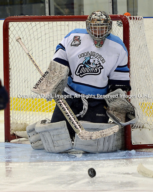 OAKVILLE, ON - Dec 14 : Ontario Junior Hockey League Game Action between the Burlington Cougars Hockey Club and the Oakville Blades Hockey Club, Brock Novak #30 of the Burlington Cougars makes the save..(Photo by Catherine Reid / OJHL Images)