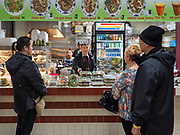 29 FEBRUARY 2020 - ST. PAUL, MINNESOTA: People at a Thai/Lao food stand in the Hmong Village. Thousands of Hmong people, originally from the mountains of central Laos, settled in the Twin Cities in the late 1970s and early 1980s. Most were refugees displaced by the American war in Southeast Asia. According to the 2010 U.S. Census, there are now 66,000 ethnic Hmong in the Minneapolis-St. Paul area, making it the largest urban Hmong population in the world. Hmong Village, the largest retail and restaurant complex that serves the Hmong community, has more than 250 shops and 17 restaurants.   PHOTO BY JACK KURTZ