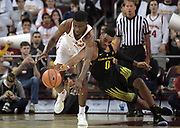 Feb 15, 2018; Los Angeles, CA, USA; Southern California Trojans forward Chimezie Metu (4) and Oregon Ducks forward Troy Brown (0) battle for the ball in the first half during an NCAA basketball game at Galen Center.