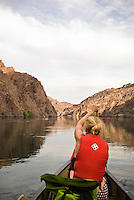 Canoer navigates the Colorado River through The Black Canyon, Nevada.