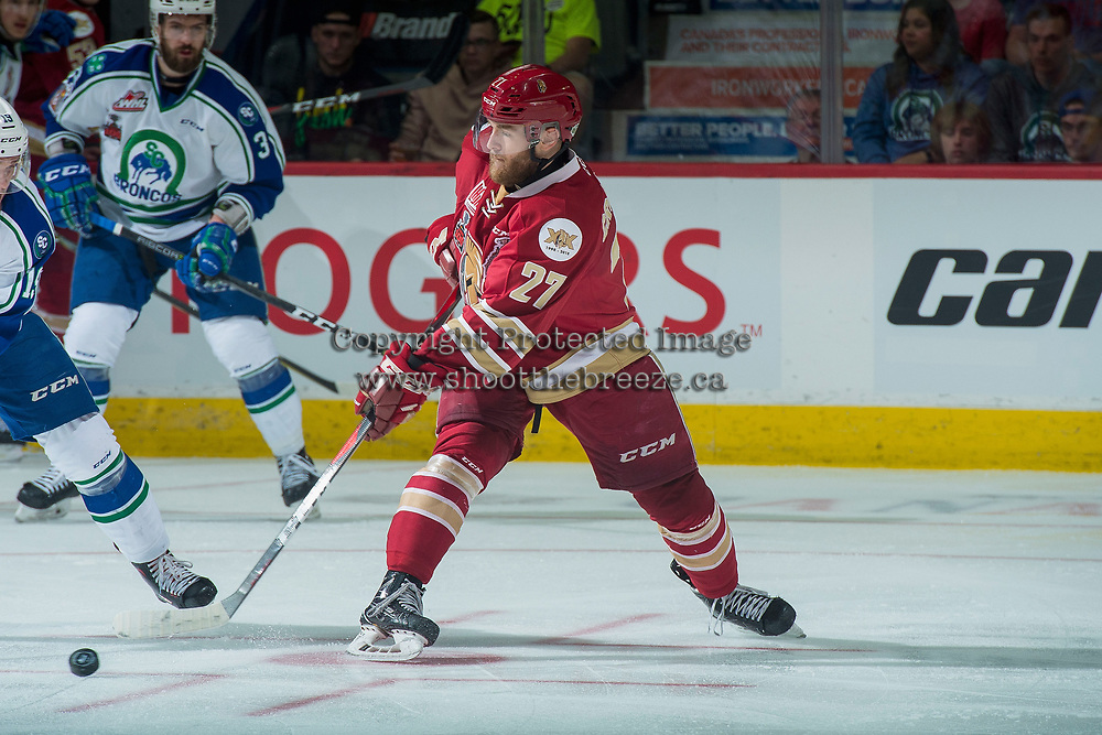 REGINA, SK - MAY 19: Ethan Crossman #27 of Acadie-Bathurst Titan passes the puck against the Swift Current Broncos at the Brandt Centre on May 19, 2018 in Regina, Canada. (Photo by Marissa Baecker/CHL Images)