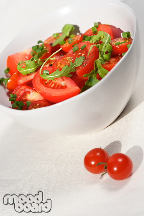 Close  - up of sliced tomatoes with rucola