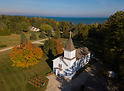 St. Michael Church in Jacksonport, Wis., is pictured in an aerial photo with Lake Michigan in the background. St. Michael is one of four churches in tourist region of Door County which make up Stella Maris Parish. (Sam Lucero | The Compass)