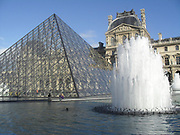 Fountain and pyramid in the Louvre courtyard, Louvre Museum, Paris