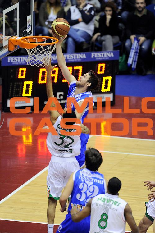 DESCRIZIONE : Milano Coppa Italia Final Eight 2014 Finale Montepaschi Siena Banco di Sardegna Sassari<br /> GIOCATORE : Drake Diener<br /> CATEGORIA : penetrazione tiro <br /> SQUADRA : Banco di Sardegna Sassari<br /> EVENTO : Beko Coppa Italia Final Eight 2014 <br /> GARA : Montepaschi Siena Banco di Sardegna Sassari<br /> DATA : 09/02/2014 <br /> SPORT : Pallacanestro <br /> AUTORE : Agenzia Ciamillo-Castoria/N.Dalla Mura<br /> GALLERIA : Lega Basket Final Eight Coppa Italia 2014 <br /> FOTONOTIZIA : Milano Coppa Italia Final Eight 2014 Finale Montepaschi Siena Banco di Sardegna Sassari