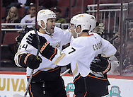 Mar. 1, 2013; Glendale, AZ, USA; Anaheim Ducks  forward Andrew Cogliano (7) is congratulated by teammate forward Daniel Winnik (34) after scoring against Phoenix Coyotes in the first period at Jobing.com Arena. Mandatory Credit: Jennifer Stewart-USA TODAY Sports