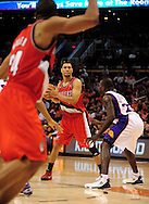 Dec. 10 2010; Phoenix, AZ, USA; Portland Trailblazers guard Brandon Roy (7) handles the ball while being guarded by Phoenix Suns guard Jason Richardson (23) during the first half at the US Airways Center. The Trailblazers defeated the Suns 101-94.  Mandatory Credit: Jennifer Stewart-US PRESSWIRE.