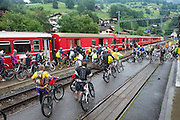 """In 2010, Swiss citizens pedaled 150 million kilometers on the Swiss National Bike Network—equivalent to the distance from the earth to the sun. In (xxx) mountain bikers use the integrated train system as a """"gondola"""" to bring them back to trailheads at higher altitudes."""