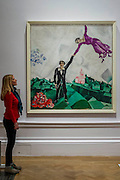 Promenade 1917-18 by Marc Chagall - Revolution: Russian Art 1917-1932 marks the centenary of the Russian Revolution.  This landmark exhibition focuses on the momentous period in Russian history between 1917, the year of the October Revolution, and 1932 when Stalin began his violent suppression of the Avant-Garde. Avant-Garde artists such as Chagall, Kandinsky, Malevich and Tatlin feature alongside the Socialist Realism of Brodsky, Deineka, Mukhina and Samokhvalov amongst others. The exhibition runs at the Royal Academy of Arts from 11 February – 17 April 2017.