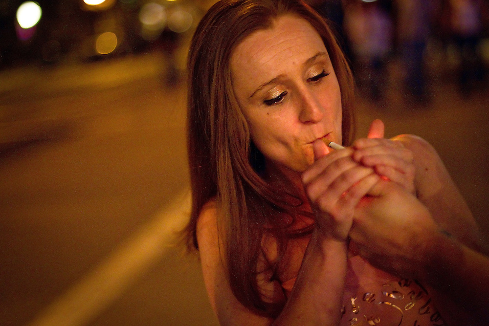 "Theresa Dilley has her cigarette lit while smoking outside the Moose Lounge in downtown Coeur d'Alene, Idaho on Friday, June 25, 2010. Theresa was watching her brother's band, ""Subtracting the Negative"" at the Moose Lounge."