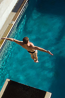 Swimmer jumping into swimming pool