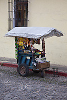Street vendors cart sits on the cobblestone streets of Antigua, Guatemala.