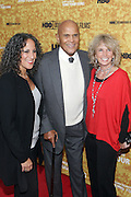 "October 6 New York, NY-  l to r: Actor/Producer Gina Belafonte, Actor/Civil Rights Activist Harry Belafonte, and Pamela Belafonte( wife) at the HBO Premiere of "" Sing Your Song"" chronicling the life & iconic career of legendary entertainer & civil rights hero Harry Belafonte held at the Apollo Theater on October 6, 2011 in Harlem, New York City. Photo Credit: Terrence Jennings"
