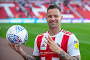 Chris Maguire (#7) of Sunderland AFC keeps the match ball after scoring a hat-trick during the EFL Sky Bet League 1 match between Sunderland and AFC Wimbledon at the Stadium Of Light, Sunderland, England on 24 August 2019.