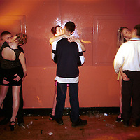 Doing what teenagers do.....The Frenzy a teenage disco night at The Queens Hall, Widnes, shot for a commission titled Double Vision, a photographic record of the Borough of Halton, Cheshire, celebrating the Millenium year...Byline/credit should read:.Terry Kane