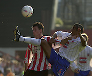 20/09/2003.Nationwide Div 2 Brentford v Hartlepool..Bee's Tommy Wright and pool's Chris Westwood contest the high ball.