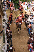 A horse gets over an obstacle, which heralds a good rice harvest at the annual Shinto Tado Horse Festival.