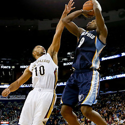 Dec 13, 2013; New Orleans, LA, USA; Memphis Grizzlies shooting guard Tony Allen (9) shoots over New Orleans Pelicans shooting guard Eric Gordon (10) during the second half of a game at New Orleans Arena. The Pelicans defeated the Grizzlies 104-98. Mandatory Credit: Derick E. Hingle-USA TODAY Sports
